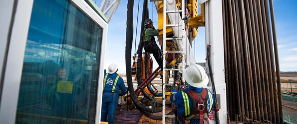 drill rig maintenance: a crew of workers inspect a rig