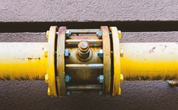 Yellow pipes bolted together with connector