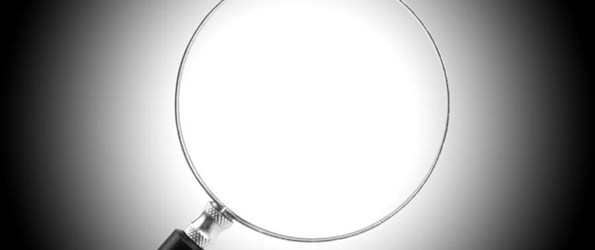 pipe inspection: a magnifying glass on a black and white background
